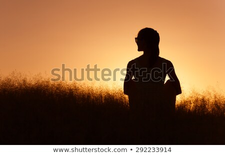 beautiful carefree woman in fields being happy outdoors stock photo © artfotodima