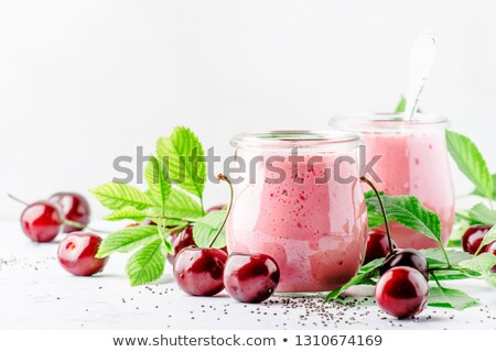 Glass jar of milk on white stone kitchen table background.Space for text Stock photo © DenisMArt