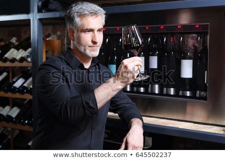 Yakışıklı olgun adam tatma cam kırmızı Stok fotoğraf © boggy