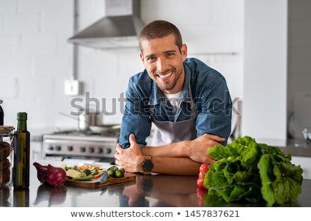 Boldog fiatalember szakács szakács kötény áll Stock fotó © deandrobot