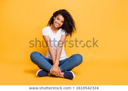 若い女性 · 座って · クロス · 青空 · 女性 · 幸せ - ストックフォト © monkey_business