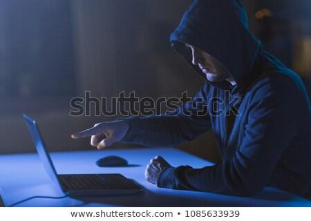 Hacker wskazując laptop ciemne pokój dział Zdjęcia stock © dolgachov