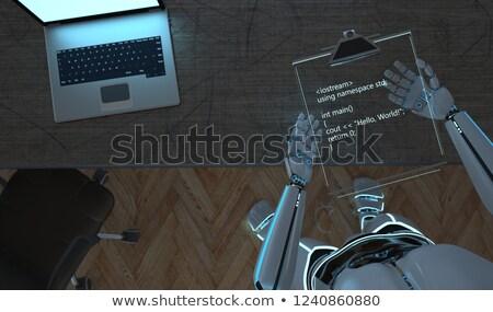humanoid robot clipboard code hello world stock photo © limbi007