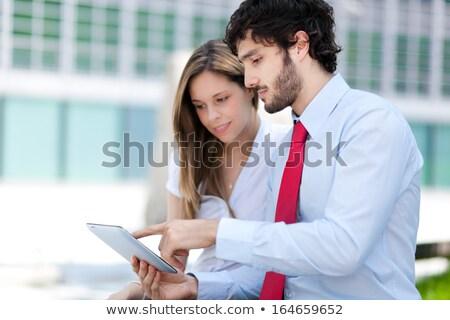 Business partners in an urban setting  Stock photo © Minervastock