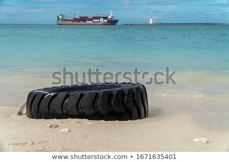 Garbage on a beautiful beach with white sand. Contamination of the environment concept Stock photo © galitskaya