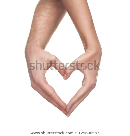 Stock photo: man and woman hands shows heart gesture