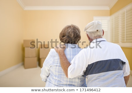 senior couple looking into empty room of house stock photo © feverpitch