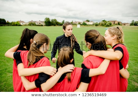 Coach coaching Girls Sports Team. Girls school sports team huddle Stock photo © matimix