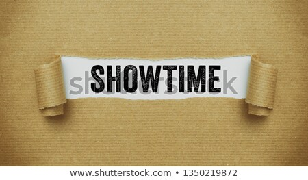 Torn brown paper revealing the word Showtime Stock photo © Zerbor