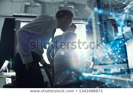 Teamwork works with a computer. Concept of internet sharing and interconnection. double exposure. Stock photo © alphaspirit