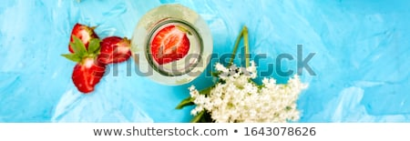 kombucha tea with elderflower and strawberry on blue background stock photo © illia