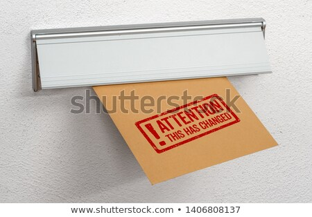 A letter stamped This has changed in a mail slot Stock photo © Zerbor