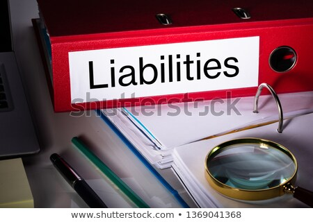 Liabilities Folder And Magnifying Glass On Desk Stock photo © AndreyPopov