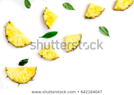 Sliced pineapple on white table stock photo © furmanphoto