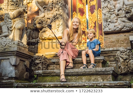 Mom and son tourists in Ubud palace, Bali - Inside the Ubud palace, Bali, Indonesia. Traveling with  Stock photo © galitskaya