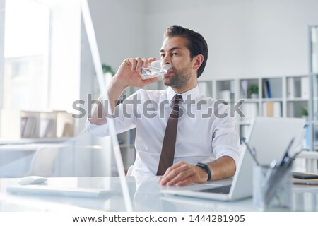 Thirsty young broker having glass of water Stock photo © pressmaster