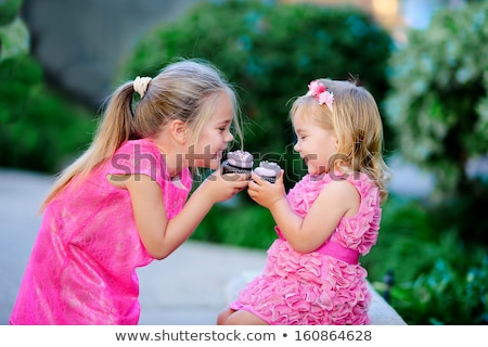 kids eating cupcakes on birthday party in summer Stock photo © dolgachov