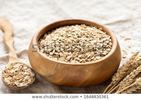 Healthy Organic Quick Oat Flakes in a Wooden Spoon Stock photo © StephanieFrey
