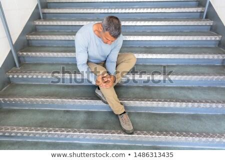 зрелый человек сидят лестница осень аварии Сток-фото © AndreyPopov
