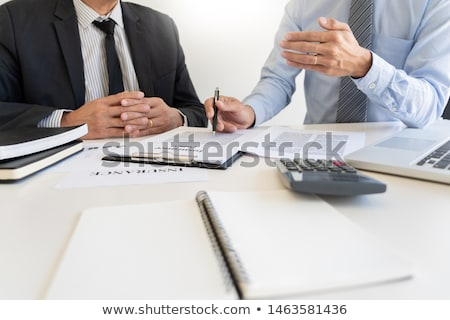 confident insurance agent broker man holding document and presen stock photo © snowing