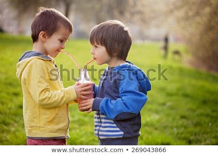 jongen · aanbieden · glas · melk · glimlachend - stockfoto © galitskaya
