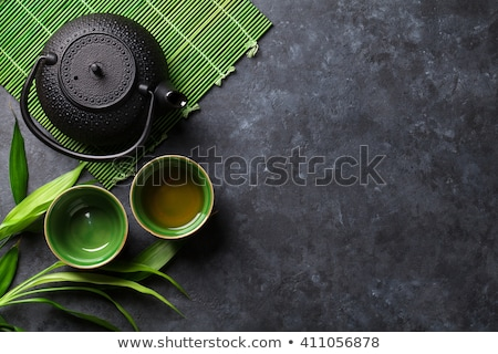 Green tea in bowls and teapot Stock photo © karandaev