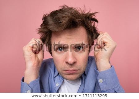 Infeliz masculino ranzinza câmera óculos Foto stock © vkstudio