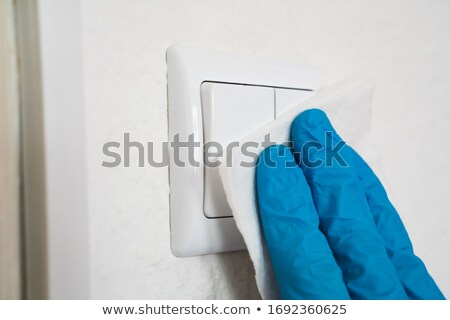 Uomo interruttore della luce virus infezione casa mano Foto d'archivio © AndreyPopov