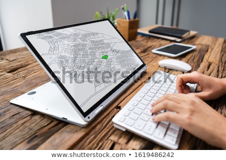 Businesspeople Analyzing Cadastre Map On Computer Stock photo © AndreyPopov