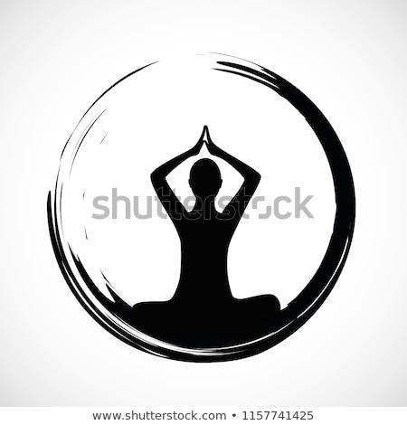 Yogi sitting in lotus pose black silhouette Stock photo © barsrsind
