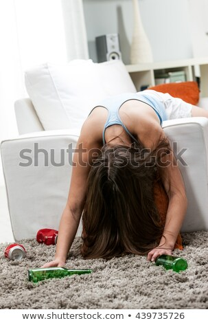 Drunk young woman draped over a sofa Stock photo © Giulio_Fornasar