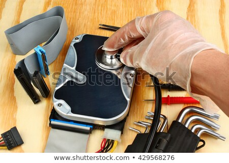Open hard drive with stethoscope Stock photo © gewoldi