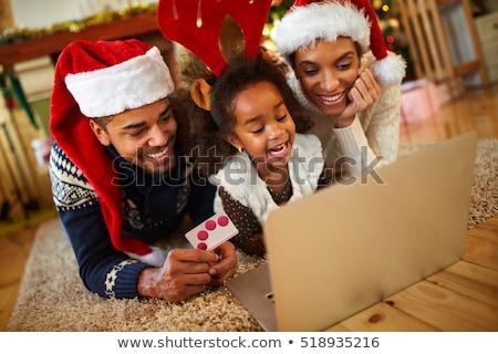 Christmas Shopping - Santa girl with a gift card Stock photo © lovleah
