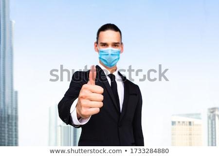 A business man gesturing ok stock photo © leeser