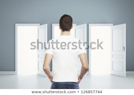 A muscular model in a white open shirt and jean Stock photo © get4net