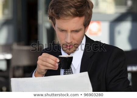 Businessman reading documents and drinking expresso Stock photo © photography33