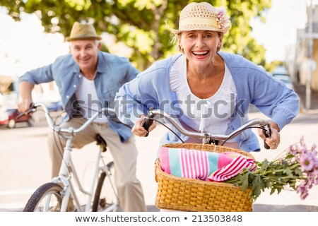 a mature couple on a bike ride stock photo © photography33