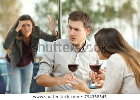Woman in a restaurant watching another couple Stock photo © photography33