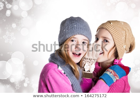secret smile with snowflakes #2 stock photo © dolgachov