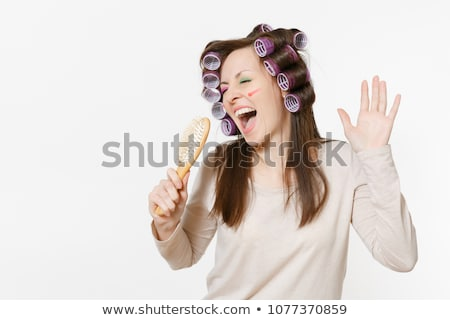 Woman singing into a blusher brush Stock photo © photography33