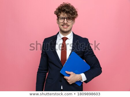 Young businessman reading contents of folder Stock photo © photography33