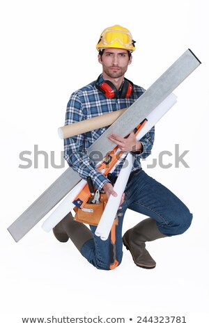Builder struggling to carry all his equipment Stock photo © photography33