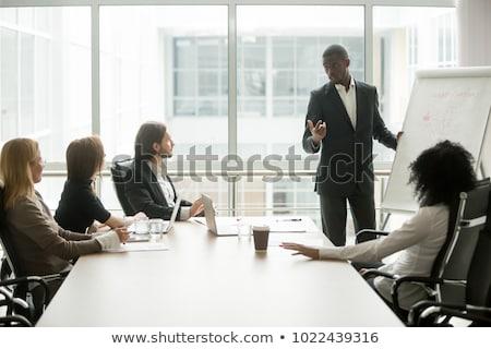 De vendas equipe em pé flipchart escritório trabalho Foto stock © photography33