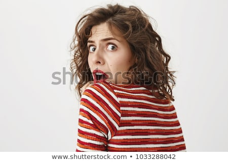 Attractive female turning back and smiling at you Stock photo © stockyimages