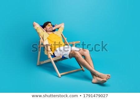 Blue lounger isolated on white Stock photo © ozaiachin