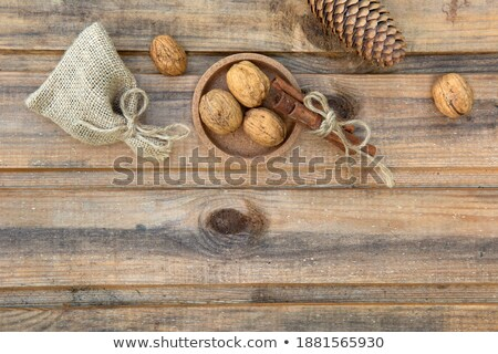 Walnuts and Cinnamon on the Burlap Background Stock photo © maxpro