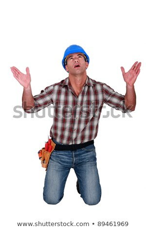 Builder on knees looking upwards Stock photo © photography33