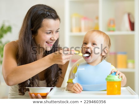 mother feeding adorable baby Stock photo © dolgachov