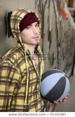 grunge basket ball street player on brickwall stock photo © lunamarina