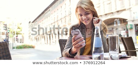 attractive businesswoman using a smartphone stock photo © stockyimages